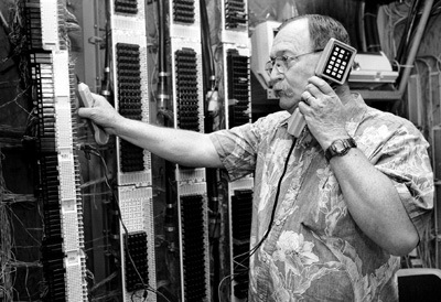 Telecommunications technician Bill Blackmur checks the main distribution frame for all buildings and dorms on campus. The main frame is located in Founder's Hall. Blackmur has been the University of La Verne's telecommunications technician for the past six years and oversees all aspects of telephone service for the University. / photo by Jen Newman