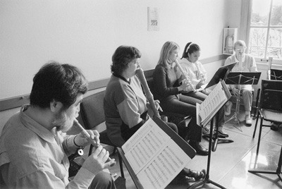 """Yoshio Kitazawa, soprano recorder, Anita Hanawalt, bass recorder, Erin Parson, alto recorder, Stephanie Abeyta, alto recorder and Mary Blocher, bass recorder, are part of the University of La Verne's Recorder Ensemble. The ensemble performed Wednesday morning in the hallway of the third floor of Founders Hall and filled the entire building with music. During their performance, the members performed """"Intrada XXXIII"""" by Johann Ghro, """"A Self Portrait"""" by Giles Farnaby, """"Passamezzo Antico"""" by Nicholas Ammerbach, """"16th Century Dances"""" from a manuscript in the British Library and """"Spring Returns"""" by Luca Marenzio. All of the pieces were composed before the 18th Century and adhere to an """"early music"""" theme. The ensemble is directed by Hanawalt and is composed of ULV students, alumni and members of the local community. The ensemble rehearses Thursday mornings in the Chapel. / photo by Tom Galaraga"""