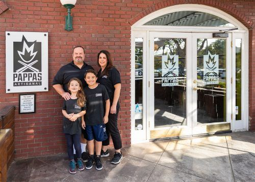 Khevin and Dimitra DeVaughn—the new owners of Pappas Artisanal located on 2232 D Street—open for business with their son Richard, 9, and their daughter Antonia, 7. Pappas is open Wednesday and Thursday 11 a.m. to 2 p.m. and 5 p.m. to 8:30 p.m., Friday 11 a.m. 2 p.m. and 5 p.m. to 9 p.m., Saturday 9 a.m. to 3 p.m. and 5 p.m. to 9 p.m. and Sunday 9 a.m. to 3 p.m. / photo by Celeste Drake