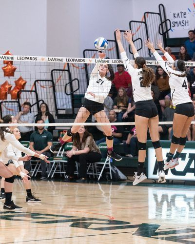 Freshman outside hitter Haley Celaya spikes a point for La Verne during the first set against Chapman on Friday in Frantz Athletic Court. The Leopards took the win from Chapman, 3-1. La Verne started the SCIAC postseason tournament Thursday at Claremont-Mudd-Scripps. / photo by Claudia Ceja