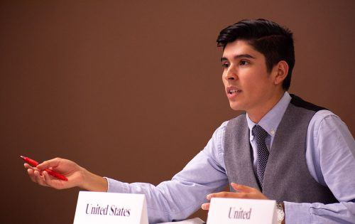 "Senior political science and economics major Nick Castellano, representing the United States, discusses the issue of ethnic cleansing at the Model United Nation's event ""Human Rights Crisis in Myanmar – Is It Genocide?"" Wednesday in the President's Dining Room. Students represented the five permanent members of the United Nations Security Council – the United States, United Kingdom, France, China and Russia – along with a representative from Myanmar. / photo by Natasha Brennan"