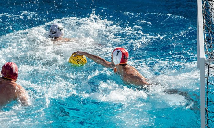 Senior goal keeper Ian Hernandez grabs the ball after an attempted goal by Claremont-Mudd-Scripps. The Leopards fell to the Stags, 12-10.