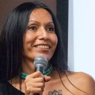 Michelle Enfield, from the Navajo Nation, spoke about the media's perception of Native Americans and her own story of starting hormone replacement therapy. Enfield is the program coordinator for the Red Circle Project that provides HIV/AIDS prevention resources for indigenous people in Los Angeles.