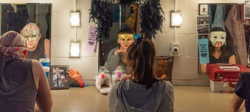 "Senior theater arts major Timothy Stribbel, freshman political science major Melissa Ochoa and freshman theater arts major Arianna Olivares gaze into the mirror wearing masks from Sophocles' play, ""Ajax."" The actors created their own masks for the production. Some wore several different masks throughout the play. / photo by Kayla Salas"