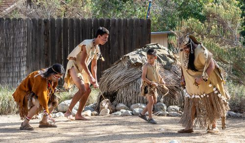 Native American dancers perform a deer hunting dance at the Rancho Santa Ana Botanic Garden's Acorn Festival Nov 18. Traditionally the dance was done to bless the indigenous people before their hunt. / photo by Veronyca Norcia