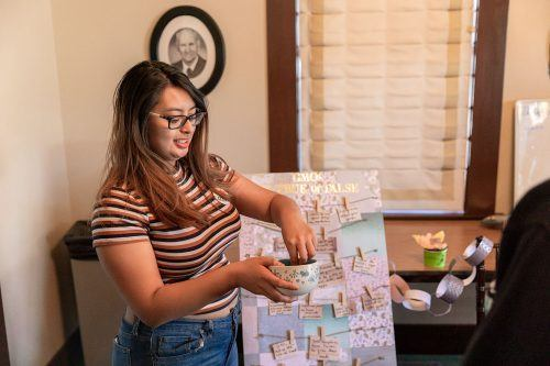 Junior biology major Angelica Sabandal conducts a true or false game on genetic modified organisms in the Hanawalt House Nov. 28. The event was hosted by the senior honors students in the biology department. / photo by Jaren Cyrus