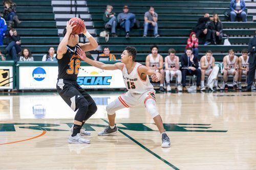 La Verne freshman guard Donnell Leffridge IV defends Occidental junior point guard Ryan Kaneshiro in the closing minutes of the game Wednesday at Frantz Athletic Court. The Tigers beat the Leopards, 77-73.