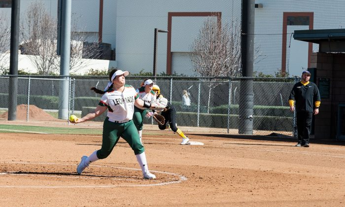 La Verne junior pitcher Katheryn Navarro faces off against Cal Lutheran in the second innning of the first game of Saturday's doubleheader at Campus West. Cal Lutheran scored four runs in the inning but La Verne won the game, 11-4. / photo by Katelyn Keeling