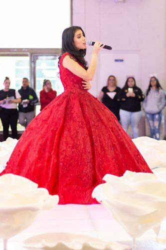 """Singer-songwriter Giselle Torres performs her song """"15"""" Sunday during the Quinceañera Expo at the Fairplex. The annual expo at the Fariplex is hosted by Quinceañera Magazine to showcase dresses and event services for teens and their families preparing for Quinceañera parties. / photo by Ashley Villavicencio"""