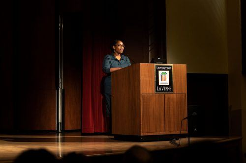 "Marcia Chatelain, professor of African American studies at Georgetown University, shares stories from her book ""South Side Girls: Growing Up in the Great Migration"" Tuesday in Morgan Auditorium. Chatelain wrote about the 1990s crises of black America. / photo by Jaren Cyrus"