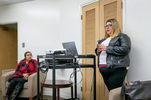 Alumna Kimberly Gonzalez speaks to students about Latinx spirituality and female figures such as La Virgen de la Guadalupe, La Malinche and Tonantzin in the Interfaith Chapel last week. This event was part of the Faith and Justice series. / photo by Molly Garry