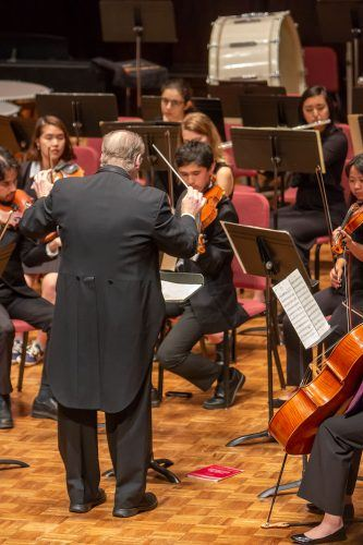 Eric Lindholm conducts the Pomona College Orchestra Sunday at Mabel Shaw Bridges Hall of Music to recognize one of their musicians who won the 2018 Pomona Concerto Competition. / photo by Ashley Villavicencio