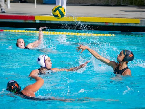 La Verne senior attacker Guarina Garcia throws past Cal Lutheran senior attacker Mardell Ramirez at the beginning of the first quarter Tuesday at the La Verne Aquatic Center. The Leopards lost, 13-12. Garcia would record two goals, an assist and a steal in the matchup. / photo by Molly Garry