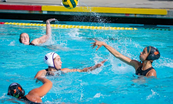 La Verne senior attacker Guarina Garcia throws past Cal Lutheran senior attacker Mardell Ramirez at the beginning of the first quarter Tuesday at the La Verne Aquatic Center. The Leopards lost, 13-12. Garcia would record two goals, an assist and a steal in the matchup.