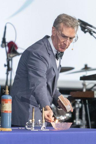 "Television science star Bill Nye demonstrates a fire and gas experiment during the second day of the annual STEAM event March 16 at the Fairplex Planetary Stage. His presentation was recorded for a new episode of his show, ""Bill Nye Saves the World,"" available for streaming on Netflix. The three seasons explore important science issues with guests who help Nye test his theories. / photo by Ariel Torres"