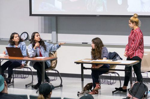 Palestinian debaters Layan Malhees (second from left) and Nura Qasrawi (second from right), join junior biology major Hanien Samara (right) and freshman political science major Noor Tabba (left) for a debate Tuesday in La Fetra Lecture Hall for Women's History Month. The debate focused on whether Ahed Tamimi's actions helped or harmed Palestinian women. Malhees and Qasrawi, members of the An-Najah University Debate Society, flew in from the Middle East to participate in the event. / photo by Kayla Salas