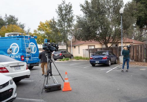 News crews surround a student's car Friday morning after it was set on fire. The incident occurred in Parking Lot H2, near Barkley Annex and Leo Hall. La Verne Police Department is investigating the incident as a hate crime. / photo by Jaysin Brandt