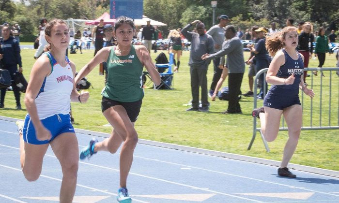 La Verne freshman Marissa Perez finishes third in her 100 meter heat at the Pomona-Pitzer Invitational Saturday. Track and field teams from around the world gathered at Strehle Track to compete in the invitational.