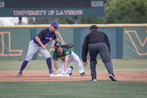 Cal Lutheran second baseman Tanner Wright fails to tag La Verne senior second baseman Ryan Galan during the bottom of the second inning Saturday at Campus West. The Leopards won all three conference games against the Kingsmen 7-0, 9-7 and 6-5. / photo by Ariel Torres