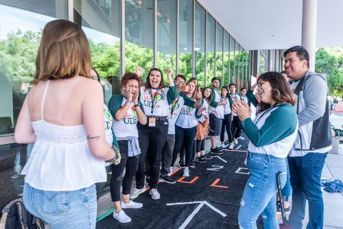 The 2019 Spotlight leaders welcome incoming students in front of the Campus Center during Saturday's Spotlight Weekend event. The three-day-long event gives students a chance to see what life is like on campus, and an opportunity to stay overnight in the dorms. / photo by Katelyn Keeling