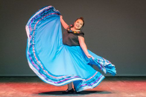 Freshman political science major Angela Garcia performs a Folklorico dance for the Cabaret Student Productions multicultural dance event Tuesday in the Dailey Theatre. The University of La Verne dance team performed dances based on Indian, Hawaiian and Mexican cultures. The event was hosted by Jennifer Gonzalez, junior theater arts major. / photo by Molly Garry