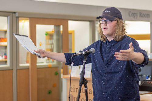 Freshman political science major Mason Stackman participates in the public debate in the Wilson Library Wednesday. The debate team discussed whether or not communities need libraries, and if libraries should have less books and make more material available online. / photo by Ashley Villavicencio