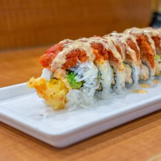 The kamikae roll at Wabi Sabi includes langostino, crab meat, shrimp tempura and avocado on the inside and is topped with spicy tuna and mayonnaise sauce. Wabi Sabi is located in La Verne at 2345 Foothill Blvd. and is open seven days a week. / photo by Kayla Salas