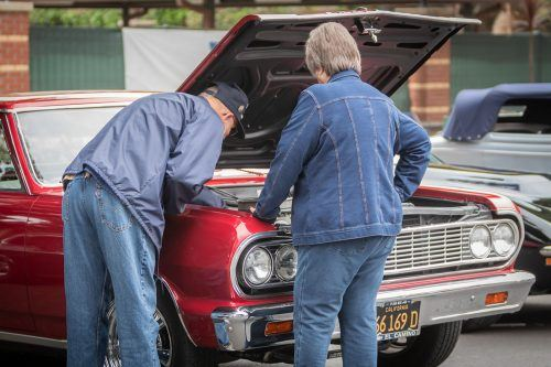 Todd and Sharon Frazier polish off their red 1964 El Camino on Saturday at the yearly Cool Cruise Car Show. The Fraziers also own a 1955 Chevrolet Bel Air. The free event takes place every spring in Old Town La Verne and features live music, food and booths. / photo by Ariel Torres