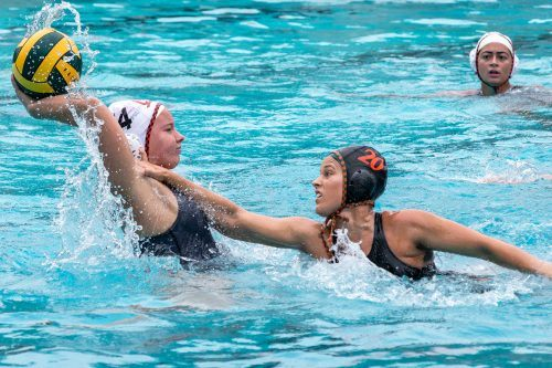 Senior attacker Victoria Mezack challenges Occidental freshman attacker Anne Werum to keep her from passing the ball to her teammate Saturday. La Verne ended the match with a win, 16-6, at the La Verne Aquatic Center. La Verne will play No. 1 seed Pomona-Pitzer 7 p.m. Friday at Haldeman Pool at the SCIAC championship tournament. / photo by Nikky Huynh