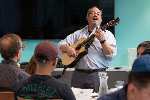 Cantor Paul Buch, from the Temple Beth Israel in Pomona, sings a traditional song that is part of the Passover Seder celebration on Tuesday in the Executive Dining Room. Nicole Temple, junior biology major and president of Hillel Club, hosted the annual event. / photo by Kayla Salas