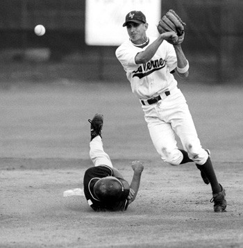 Shortstop Eddie Muñoz turns an easy double play during last Friday's 10-2 victory against the University of Redlands. This was the first of two wins in the three-game series. / photo by Juan Garcia