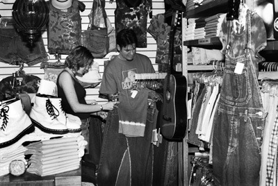 Chrissy Ford and Brandon Adams shop at the vintage clothing store Rigobeagle, in Glendora. Warren Belteton, assistant store manager, said what they have at the Rigobeagle is original and most of the clothing is not expensive. / photo by Naoko Yokota