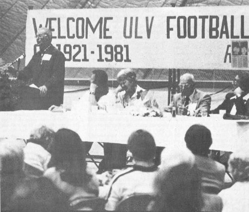 "WELCOME BACK – Vernon ""Red"" Weybright, master of ceremonies at the University of La Verne's ""60 years of Football"" banquet, welcomes alumni to the 60-year cele­bration. (from left) Weybright; Roland Ortmayer, 1981 head foot­ball coach and wife Cornelia; Bert Betts, La Verne's first football cap­tain; and Dwight Hanawalt, head of athletics at La Verne. / photo by Steve Johnson"