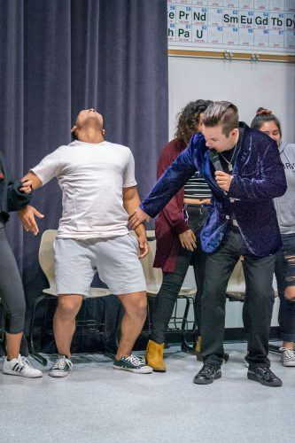 David Hall, a hypnotist from Massachusetts, hypnotizes sophomore business administration major Marcus Blevins to do the Harlem Shake. Blevins also performed as Beyoncé during the event. The Campus Activity Board held the interactive performance on Monday in LaFetra Lecture Hall. / photo by Molly Garry