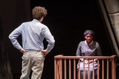 "Dalen Todorov, freshman psychology major, and Shyonta Glothon, sophomore psychology and theater major, act out a scene from the spring theater production, ""Machinal,"" Tuesday in Dailey Theatre. The play runs at 7:30 p.m. Friday, Saturday and Sunday with a matinée showing at 2 p.m. Sunday. / photo by Jaysin Brandt"
