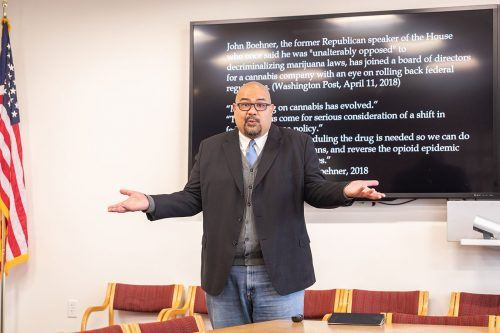 "Ian Lising, associate dean of the College of Arts and Sciences, speaks about his book, ""The Spin Doctrine: Communicating Belief, Truth and Fact,"" Tuesday in the Howell Board Room. Lising discussed the societal impacts of spin-doctoring in regards to marijuana. / photo by Jaren Cyrus"