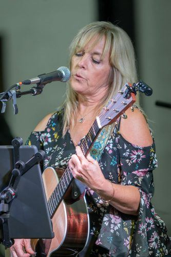 Stacey Rosen-Sturgis plays guitar for the soft rock and blues band Soulshine. The performance took palce Friday night in the public plaza at the Claremont Village. The free weekly Friday Nights Live concerts will run through October. / photo by Ariel Torres