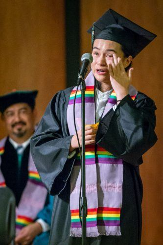 Art and art history major Damairis Lao gives a shout out to University Chaplain Zandra Wagoner at the University of La Verne's first Unity in Diversity cultural graduation ceremony May 16 in Morgan Auditorium. Lao received the lavender LGBTQ sash. / photo by Molly Garry