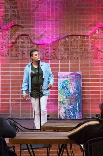 """Treesje M. Powers, a spoken word artist and co-host, performs the opening act of """"Lionlike Mindstate"""" Friday at the Millard Sheets Art Center at the Fairplex in Pomona. / photo by Katelyn Keeling"""