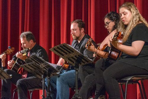 Guitarists Jeff Van Voorhis, Stu Stoddard, Ashley Avilez and senior photography major Dorothy Gartsman, play several songs ranging from flamenco to Irish folksongs in the Morgan Auditorium, Friday during the Guitar Ensemble perfromance. / photo by Kayla Salas