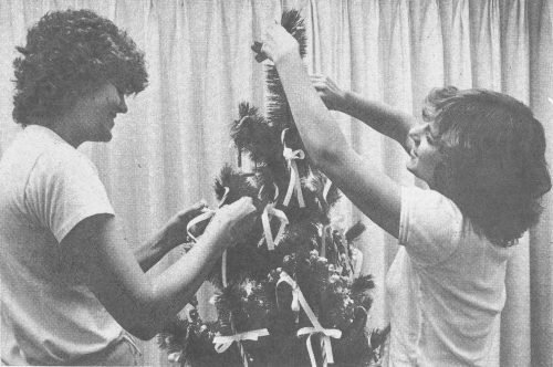 HOLIDAY SPIRIT - Sophomores Jill Montz (left) and Pam Walls display some pre-Christmas spirit by adorning their Christmas tree with ribbons, popcorn and lights. Christmas at ULV Is the time when students often get Into the yule-tide feeling. This year's activities Include a Christmas Dinner In which all students are invited and the annual Christmas Dance. / photo by Christy Tyler