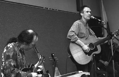 John York, a former member of the Byrds, awakened the La Verne public library last Saturday with a musical performance. York accompanied by Patrick Brayer played an array of musical instruments and songs for a crowd in the children's reading room. / photo by Jason Cooper