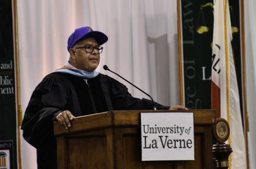 Robert Ruiz, director of forensics threw on his Los Angeles Dodgers hat while he spoke to new and returning students and faculty at Convocation Aug. 28 in the Athletics Pavilion. The event rang in the University's 128th year. / photo by Maydeen Merino