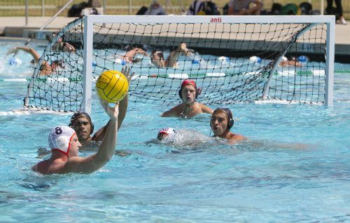 Leopard attackers, junior Guillermo Ocasio and freshman Gage Unsoeld, defend a pass from Sunbird freshman utility Zach Zetz in their Sunday game against Fresno Pacific. La Verne dropped the game, 14-13. / photo by Melody Blazauskas