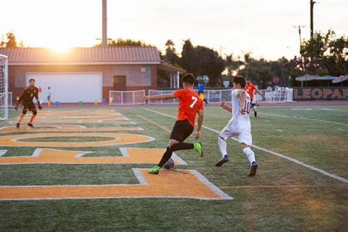 Leopard junior forward James Coe centers the ball toward his teammate, junior midfielder Ryan Mendoza, for a chance to score on the Sagehens. La Verne would win the game over Pomona-Pitzer, 1-0, Sunday. The Leopards will travel to St. Katherine on Monday. / photo by Nathan Hua
