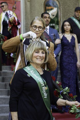 Marjorie Bothwell, class of 1969, is re-crowned Homecoming queen by Felecia Beardsley, cultural and natural history collections director, during Homecoming on Saturday in front of Founders Hall. The crown was lost and then found again 50 years later. / photo by Melody Blazauskas