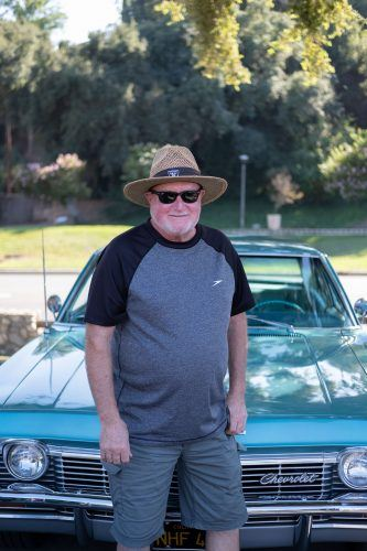 Chuck Piccolini, West Covina resident, shows off his 1965 Chevrolet Bel Air at the National Hot Rod Association Motorsports Museum's Twilight Cruise Wednesday at the Fairplex. / photo by Nathan Hua