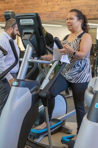 Pam Maunakea, kinesiology business manager, breaks in the new eliptical at the Randall Lewis Center for Well-Being and Research soft opening Wednesday. The Center will host its grand opening from 3:30 to 5 p.m. Oct. 18 as part of Homecoming weekend. / photography by Ariel Torres