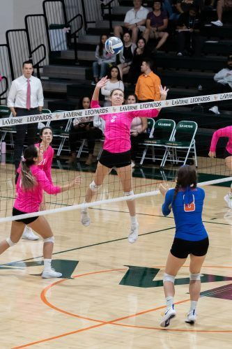 Leopard freshman outside hitter Ayana Mier goes up spike the ball over Sagehen senior opposite hitter Isabel Kelly. The Leopards would go on to take the game in a 3-0 sweep on Tuesday night. / photo by Ariel Torres