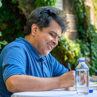 "Author Brando Skyhorse signs copies of his memoir ""Take This Man"" after his One Book, One University keynote lecture Wednesday in Fasnacht Court."